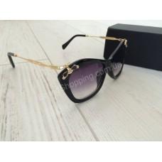Солнцезащитные очки Miu Miu 0180