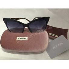 Солнцезащитные очки MIU MIU с леопардовыми дужками 8538O