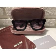 Солнцезащитные очки MIU MIU Lux чёрные SMU21NS