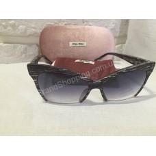 Солнцезащитные очки MIU MIU с матовой оправой S8538O