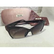 Солнцезащитные очки MIU MIU коричневые S8538O