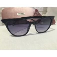 Солнцезащитные очки MIU MIU черные 2407O