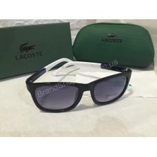 Солнцезащитные очки Lacoste Lux черные c сине-белыми полосатыми дужками 2507