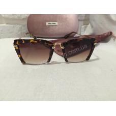 Солнцезащитные очки MIU MIU коричневые 136O