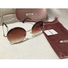 Солнцезащитные очки круглые MIU MIU коричневые OMU51NS