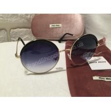 Солнцезащитные очки круглые MIU MIU черные в золотистой оправе OMU51NS