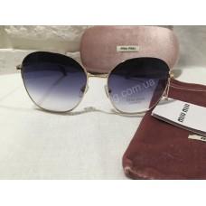 Солнцезащитные очки MIU MIU чёрно-серые в золотистой оправе OMU53NS1