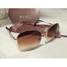 Солнцезащитные очки MIU MIU коричневые OMU53NS2