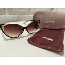 Солнцезащитные очки MIU MIU коричневые 0808S