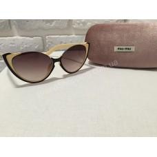 Солнцезащитные очки MIU MIU коричневые в светлой оправе 0808C5