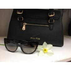 Солнцезащитные очки Miu Miu 1109